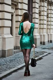 gorgeous legs in a green sequined mini dress seamed stockings and