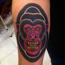 guy with traditional blue gorilla design tattoo on bicep
