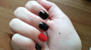 u k women have black dots on their hands for a very important reason
