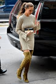 sweater dress and cozy chic chrissy teigen s sweater dress and the knee boot