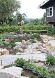 Backyard Creek Ideas Dry Creek Bed With Fish Bisecting Garden The Outlaw Gardener