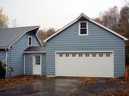 the house doctor garage design and build remodeling painted garage addition with siding and roof extension blended into house