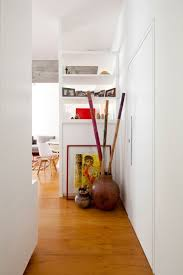 apartments white wall with hallway leading to living room and