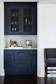 blue kitchen island and white cabinets navy blue custom kitchen cabinets all stations