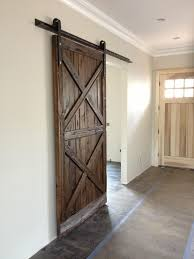 Barn Style Sliding Door by Barn Door Design Company Large Trendy Entry Hall Photo In Orange