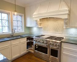 kitchen backsplash for kitchen with white cabinets features grey