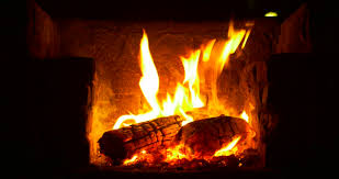 Sparks Fireplace - fire flames with sparks on a black background stock footage video