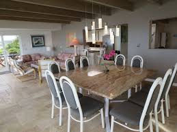 ocean front vacation rental at santa cruz beach dining changed with a new granite table for 10 people new lighting and you can see the travertine floors that have now replaced all of the carpeting upstairs