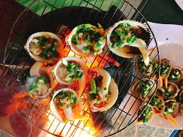 canape firr delicious shell or clams mussels on coal grill stock