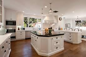 all white kitchen design with wrought iron lantern style pendant