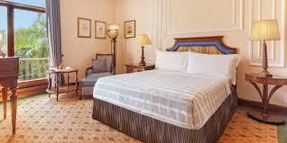 premier hotel room with balcony the oberoi grand kolkata 5