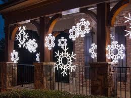 outdoor hanging snowflake lights christmas decorating with lighted snowflakes christmas lights etc