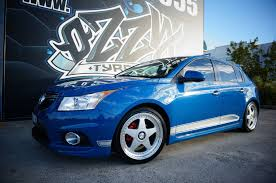 teal car white rims holden cruze rims available from ozzy tyres australia