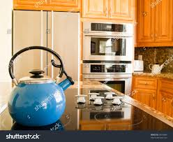 modern american kitchen bright blue traditional whistling kettle modern stock photo
