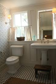 29 best toilet ideas images on pinterest bathroom ideas toilet love the floor tile the bard and batten wall the ledge behind the sink and toilet the wallpaper the wall sconce
