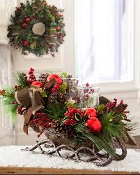 our lodge sleigh hurricane centerpiece features a miniature
