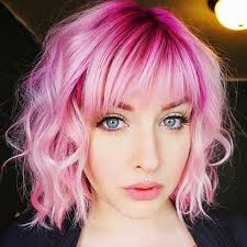pinks current hairstyle bright pink and pastel blonde coloring look great on this curly