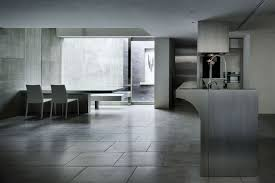 house of silence by form kouichi kimura architects keribrownhomes simple modern kitchen and dining room design with ceramic floor tiles exposed concrete wall and stainless