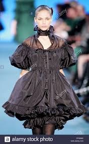 spanish style black ruffled dress with frilly neck and puffy