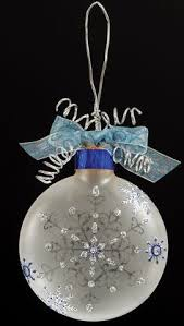 use snowflake stickers or cut some out of glitter paper using the