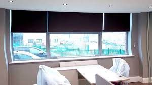 commercial electric hard wired motorised roller blinds installed