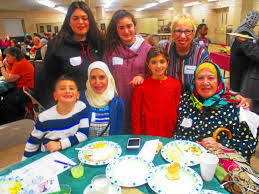 friends neighbors gather for middle eastern thanksgiving at