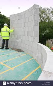 Build A New House A Builder Inspects Concrete Blocks Used To Build A Circular Turret