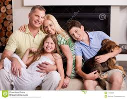 Happy Family In Living Room With Dog Royalty Free Stock Photo - Family in living room