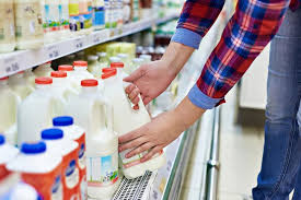popular grocery stores why milk is in the back of the store reader s digest