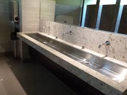 Trough Bathroom Sink With Two Faucets by Overly Long Marble Steel Trough Sink Two Faucets Under Mirrored