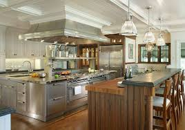 Custom Kitchen Island Designs - gas stove with copper range hoods and gucci backsplash for awesome
