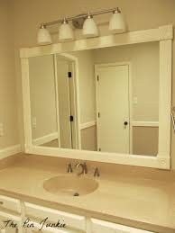 wood trim around bathroom mirror