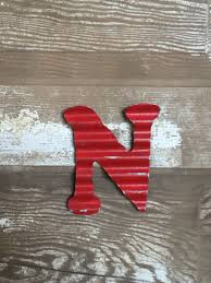 red painted corrugated metal wall letters home decor initial