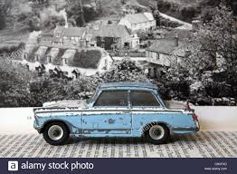 blue triumph herald coupe vintage dinky toy car with photograph