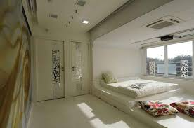 modern white bedroom with sunlight design by sonali shah master