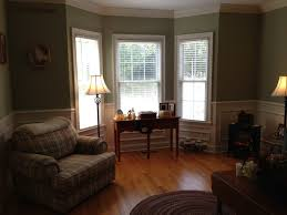 window laminating floor in modern living room with bay window also