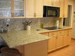 granite countertop glossy white cabinets tin backsplash can