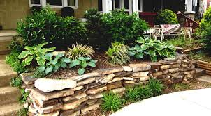 front yard garden design before sloping granite boulders