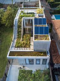 Eco Friendly House by Eco Friendly House Built Around A Vertical Garden
