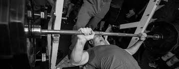 bench priest bench lee priest doing leg extensions on ironmaster