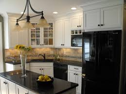 furniture black corian countertop with white cabinets and pendant