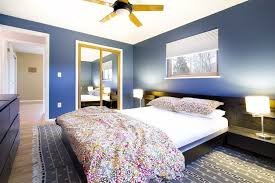 contemporary master bedroom with ceiling fan u0026 hardwood floors in