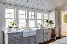 white kitchen cabinets with farm sink freshen up a farmhouse kitchen with shaker cabinets best