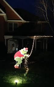 grinch stealing christmas lights christmas character yard stealing christmas lights