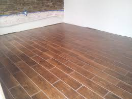 x 24 floor tile that looks like wood planking above rpm mats