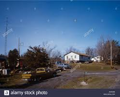 rural canadian homes with old cars pickup truck junk in the front