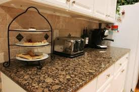 Baltic Brown Granite Countertops With Light Tan Backsplash by This Is My Granite Wanting To Paint My Cabinets White