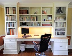 large white wooden bookshelf with white wooden drawers and desk