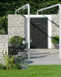 steel walls and soft grasses in travel influenced mirador garden