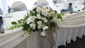 wedding bridal table flowers rehearsal dinner flowers floral